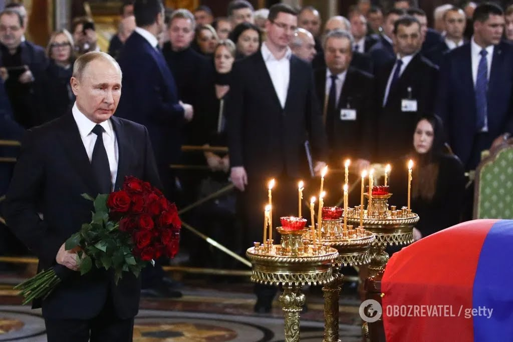 Путин на похоронах Лужкова